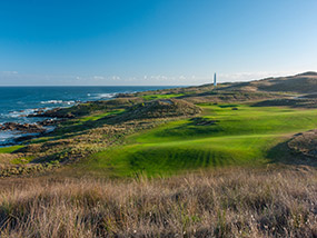 The par four 14th played toward the Cape Wickham Lighthouse
