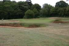 Nasty bunkering surrounds the short 10th green